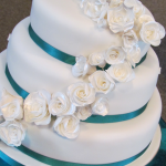 White Lustre Roses and Teal ribbon