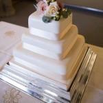 Square Ivory Wedding cake with fresh flowers